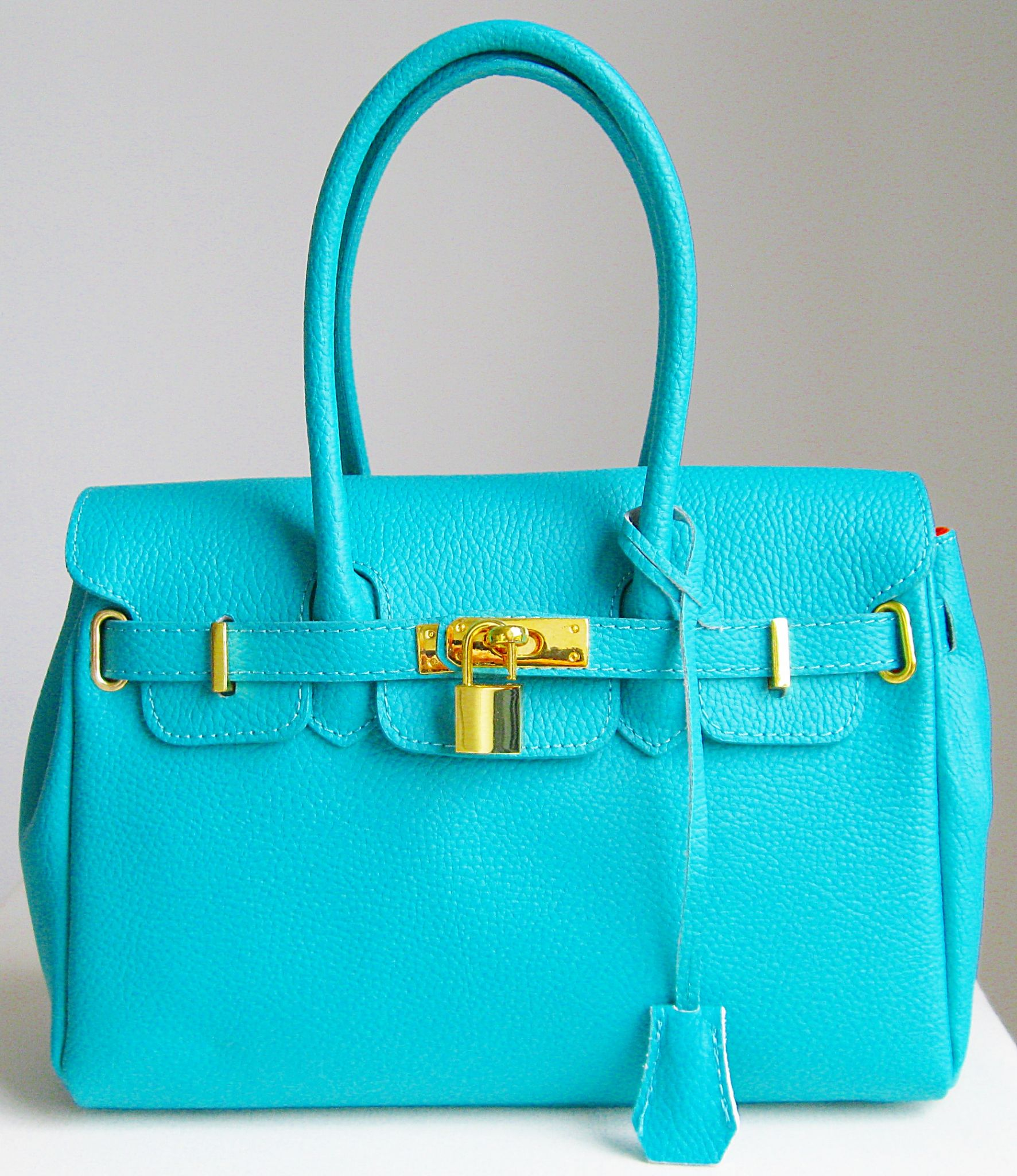 e02fa42cc7 The results of the research turquoise leather handbag